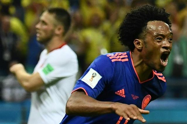 Colombia's forward Juan Cuadrado celebrates after scoring during the Russia 2018 World Cup football match against Poland, which Colombia won ending Poland's run to the cup (AFP Photo/Jewel SAMAD)