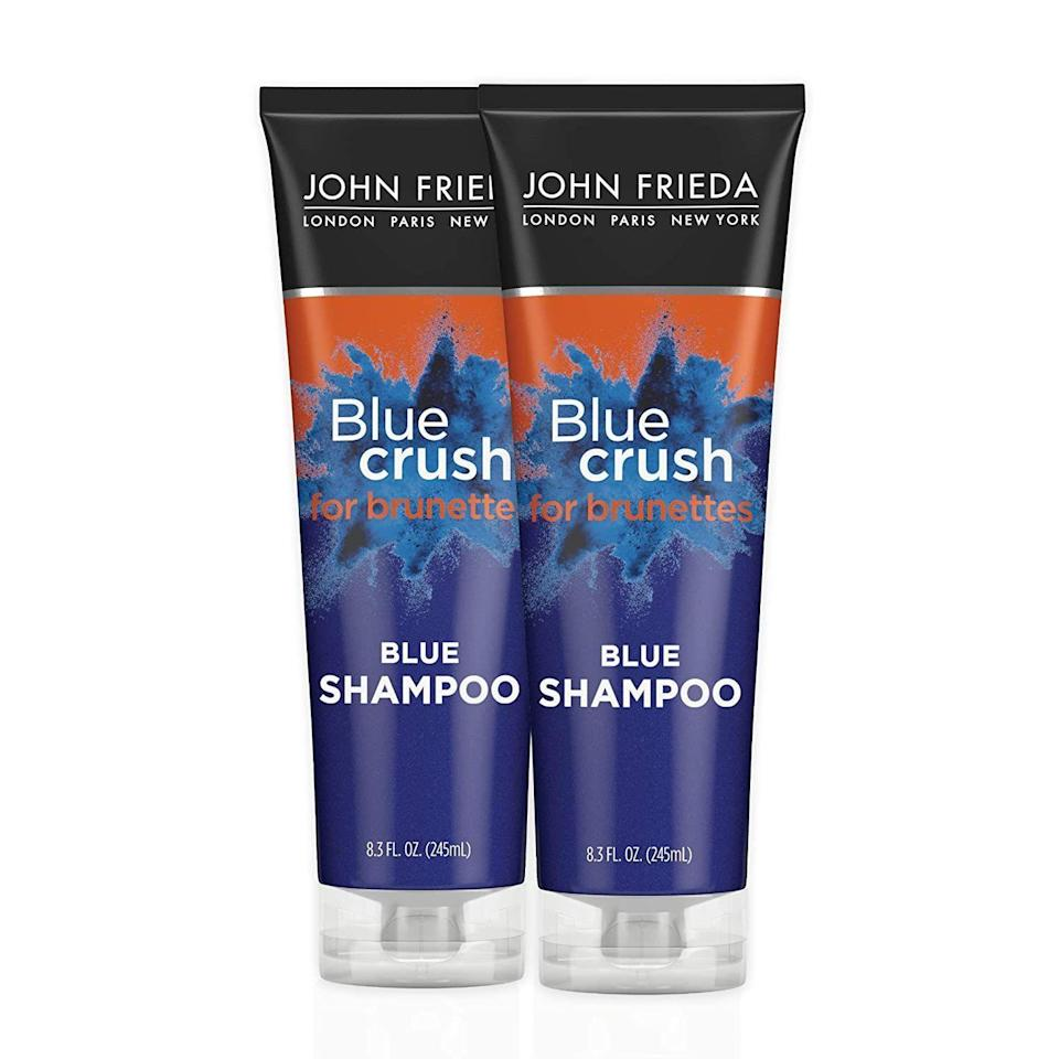 """<p><strong>John Frieda</strong></p><p>amazon.com</p><p><strong>$19.94</strong></p><p><a href=""""https://www.amazon.com/dp/B08ZYNM8M8?tag=syn-yahoo-20&ascsubtag=%5Bartid%7C10056.g.37059982%5Bsrc%7Cyahoo-us"""" rel=""""nofollow noopener"""" target=""""_blank"""" data-ylk=""""slk:Shop Now"""" class=""""link rapid-noclick-resp"""">Shop Now</a></p><p>Like purple for blondes, blue shampoo helps neutralize orange or brassy tones in shades of brunette. Even better, this formula is safe to use on both natural and not-so-natural hues.</p>"""
