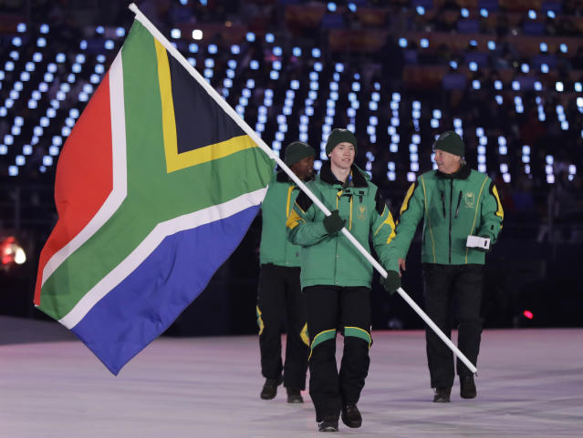 <p>Connor Wilson carries the flag of South Africa during the opening ceremony of the 2018 Winter Olympics in Pyeongchang, South Korea, Friday, Feb. 9, 2018. (AP Photo/Petr David Josek) </p>
