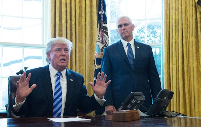 """Pence and his staff have worked hard not to eclipse Trump or show any hint of difference with him, with one senior aide saying """"the vice president's role, other than being the president of the Senate, is 100 percent defined by the president"""" (AFP Photo/MANDEL NGAN)"""
