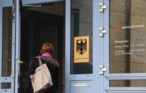 A woman enters an office of Federal Labour Agency in Nuremberg