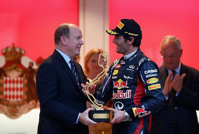 MONTE CARLO, MONACO - MAY 27: Mark Webber of Australia and Red Bull Racing receives the winners trophy from Prince Albert II of Monaco following the Monaco Formula One Grand Prix at the Circuit de Monaco on May 27, 2012 in Monte Carlo, Monaco. (Photo by Clive Mason/Getty Images)
