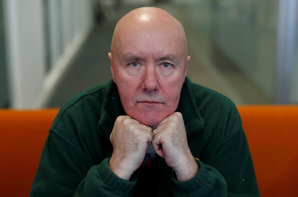 Scottish author Irvine Welsh poses for a photograph during an interview with Reuters ahead of the premiere of the film