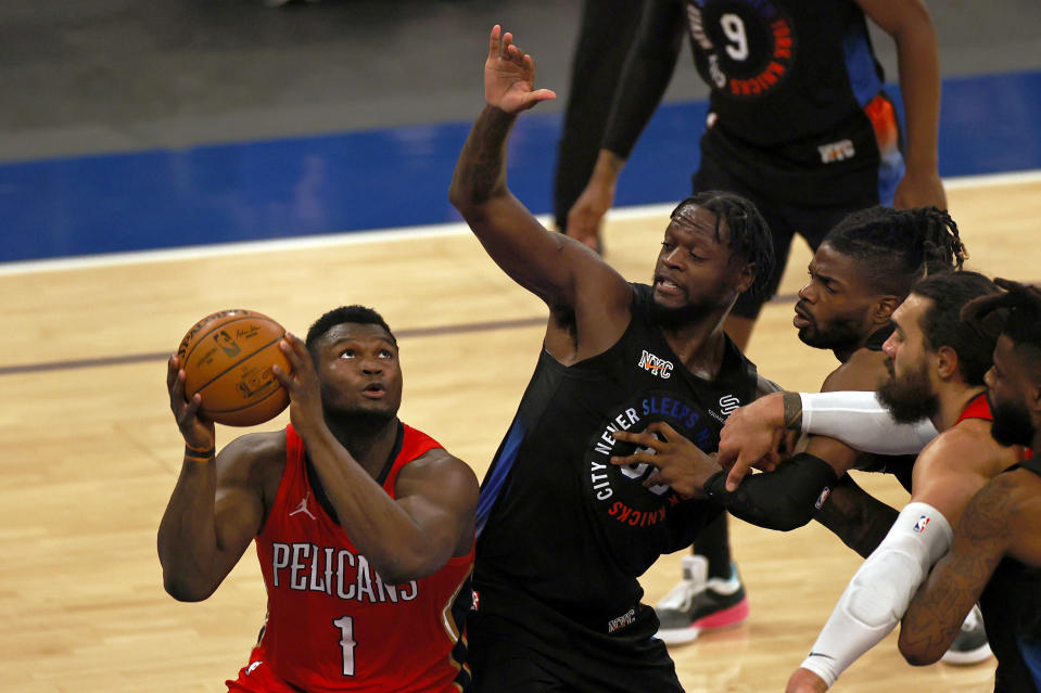 New Orleans Pelicans forward Zion Williamson (1) drives to the basket against New York Knicks forward Julius Randle during the first half of an NBA basketball game Sunday, April 18, 2021, in New York. (AP Photo/Adam Hunger, Pool)