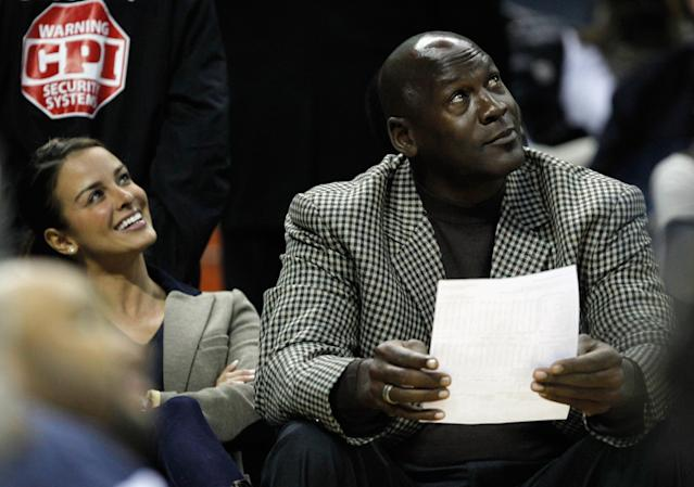 CHARLOTTE, NC - JANUARY 14: Charlotte Bobcats owner, Michael Jordan sits beside fiance, Yvette Prieto during the Golden State Warriors versus Charlotte Bobcats game at Time Warner Cable Arena on January 14, 2012 in Charlotte, North Carolina. NOTE TO USER: User expressly acknowledges and agrees that, by downloading and or using this photograph, User is consenting to the terms and conditions of the Getty Images License Agreement. (Photo by Streeter Lecka/Getty Images)
