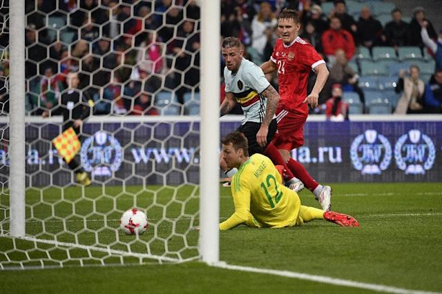 Russia's forward Alexander Bukharov scores a goal past Belgium's goalkeeper Simon Mignolet during an international friendly football match between Russia and Belgium at the Fisht Arena in Sochi on March 28, 2017 (AFP Photo/Alexander NEMENOV)