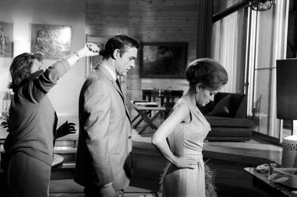 <p>Sean Connery gets his hair fixed, while Luciana Paluzzi focusses before shooting a scene for 'Thunderball', 1965. </p>