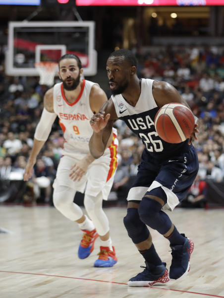 United States' Kemba Walker, right, dribbles past Spain's Ricky Rubio during the second half of an exhibition basketball game Friday, Aug. 16, 2019, in Anaheim, Calif. (AP Photo/Marcio Jose Sanchez)