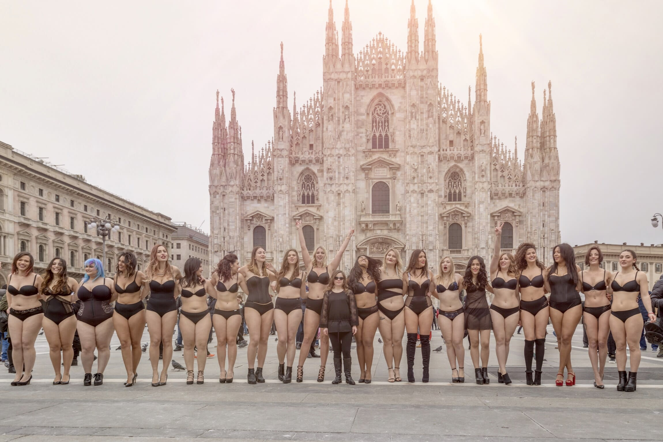 Italian Women Pose in front of a cathedral in their underwear
