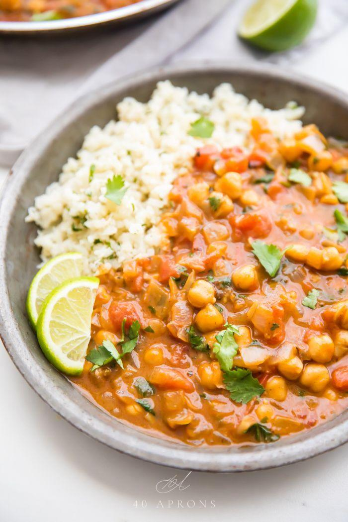 "<p>Get the <a href=""https://40aprons.com/quick-creamy-vegan-coconut-chickpea-curry/"" rel=""nofollow noopener"" target=""_blank"" data-ylk=""slk:Vegan Coconut Chickpea Curry"" class=""link rapid-noclick-resp"">Vegan Coconut Chickpea Curry</a> recipe.</p><p>Recipe from <a href=""https://40aprons.com/"" rel=""nofollow noopener"" target=""_blank"" data-ylk=""slk:40 Aprons"" class=""link rapid-noclick-resp"">40 Aprons</a>. </p>"