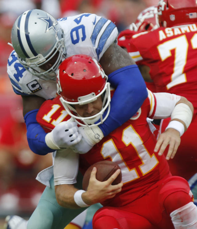 Kansas City Chiefs quarterback Alex Smith (11) is sacked by Dallas Cowboys defensive end DeMarcus Ware (94) during the first half of an NFL football game at Arrowhead Stadium in Kansas City, Mo., Sunday, Sept. 15, 2013. (AP Photo/Ed Zurga)