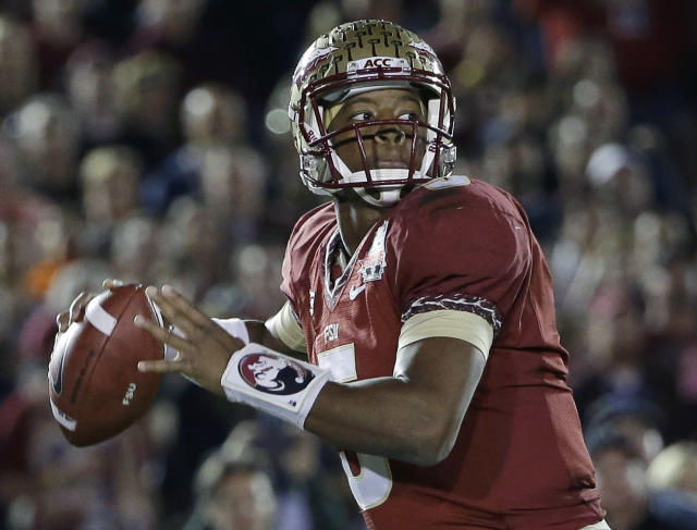 FILE - In this Jan. 6, 2014, file photo, Florida State's Jameis Winston (5) throws during the first half of the NCAA BCS National Championship college football game against Auburn in Pasadena, Calif. Winston and defending national champion Florida State are No. 1 in The Associated Press preseason college football poll. (AP Photo/David J. Phillip, File)