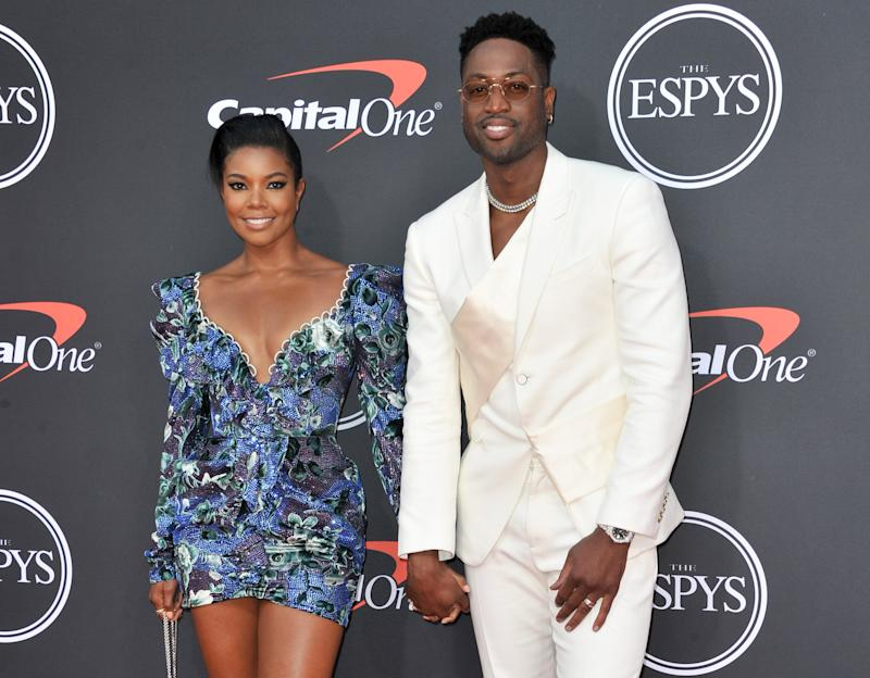 Gabrielle Union and Dwyane Wade designed T-shirts to support the LGBTQ community. (Photo by Allen Berezovsky/WireImage)