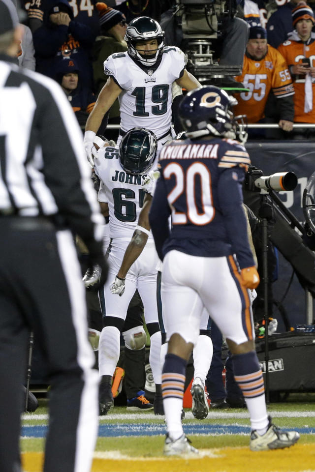 Philadelphia Eagles wide receiver Golden Tate (19) celebrates a touchdown with offensive tackle Lane Johnson (65) during the second half of an NFL wild-card playoff football game against the Chicago Bears Sunday, Jan. 6, 2019, in Chicago. (AP Photo/David Banks)