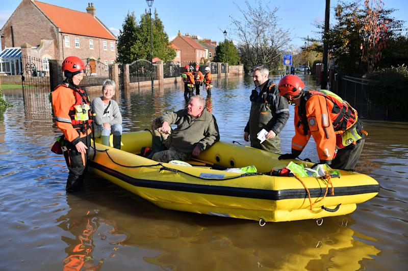 Fire and rescue crews transport people through floodwater to other parts of Fishlake, Doncaster as parts of England endured a month's worth of rain in 24 hours, with scores of people rescued or forced to evacuate their homes. (Photo by Ben Birchall/PA Images via Getty Images)