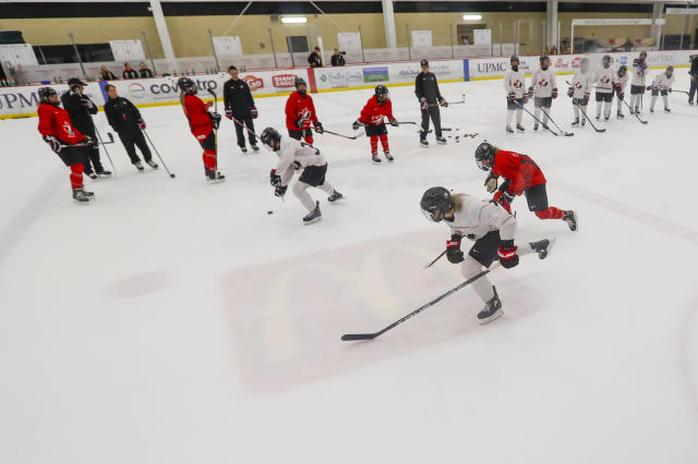 In this photo taken Monday, Nov. 4, 2019, members of the Canada Women's National hockey team drill during their practice in Cranberry Township, Butler County, Pa. Many of the top women's hockey players on the planet say they're resolute in their decision to not play professionally in North America until a new league that provides better pay and better benefits materializes. (AP Photo/Keith Srakocic)