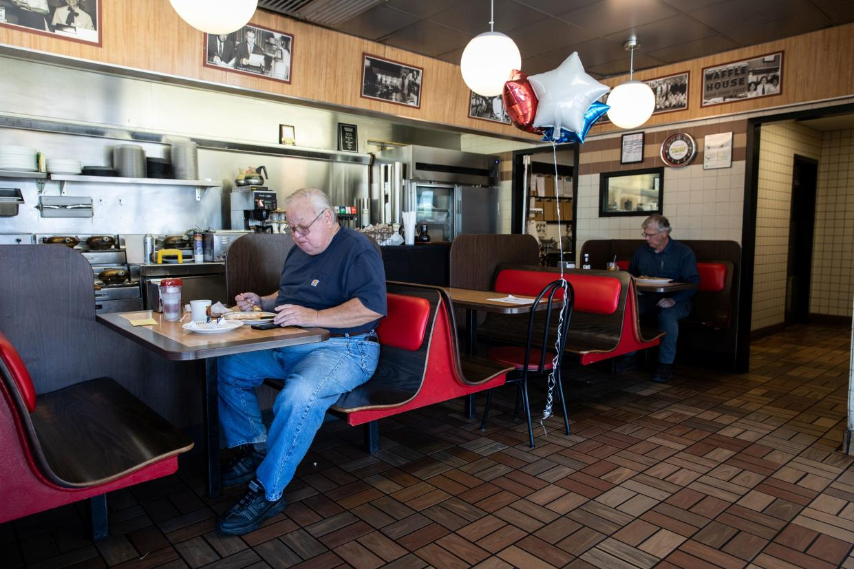 Men are pictured at a Waffle House, one of few corporate restaurant chain reopened for  in-house dining after a shutdown to prevent the spread of the coronavirus disease (COVID-19) in Madison, Georgia, U.S., April 27, 2020.  REUTERS/Maranie Staab