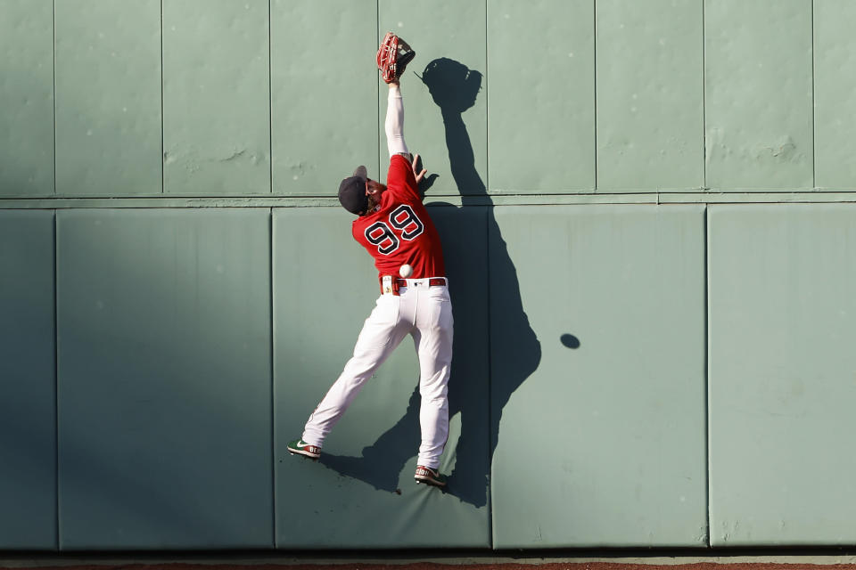 Boston Red Sox's Alex Verdugo cannot get to a baseball game-tying inside-the-park home run by Tampa Bay Rays' Austin Meadows during the ninth inning Monday, Sept. 6, 2021, at Fenway Park in Boston. (AP Photo/Winslow Townson)