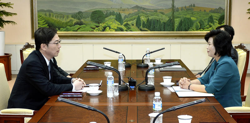 """In this photo released by the South Korean Unification Ministry, South Korea's Unification Policy Officer Chun Hae-sung, left, talks with the head of North Korea's delegation Kim Song Hye, right, during their meeting at the southern side of Panmunjom which has separated the two Koreas since the Korean War, in Paju, north of Seoul, South Korea, Sunday, June 9, 2013. Government delegates from North and South Korea began preparatory talks Sunday at the """"truce village"""" on their heavily armed border aimed at setting ground rules for a higher-level discussion on easing animosity and restoring stalled rapprochement projects. (AP Photo/South Korean Unification Ministry)"""