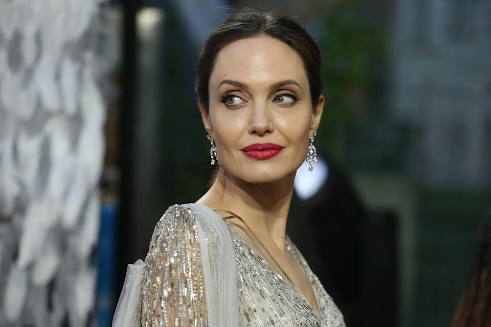 US actress Angelina Jolie poses on the red carpet upon arrival for the European premiere of the film