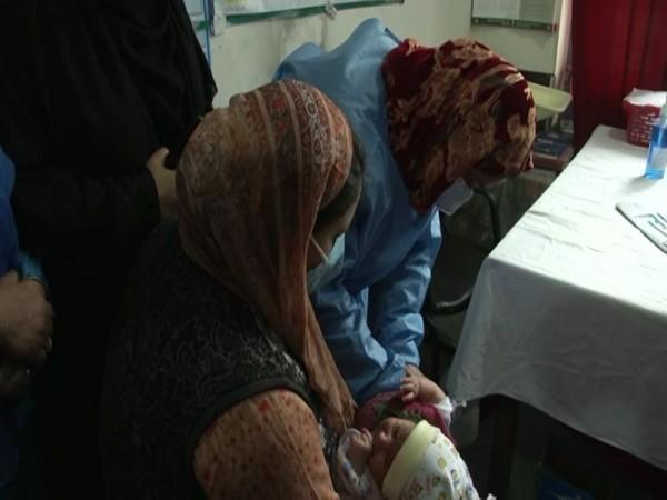 An infant being administered pneumococcal vaccine in Srinagar on Saturday. [Photo/ANI]