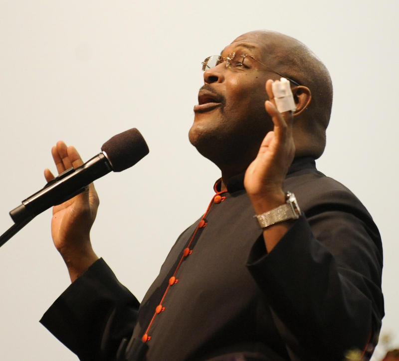 The Rev. Marvin Winans preaches during a Sunday morning service at Perfecting Church in Detroit, Sunday May 20, 2012, his first appearance before the whole congregation since being beaten and carjacked this week. The 54-year-old gospel singer and pastor of Detroit's 4,500-member Perfecting Church told congregants Sunday that he was never afraid during Wednesday's attack but feels a lingering regret over what it says about the state of the community. (AP Photo/Detroit News, David Coates)  DETROIT FREE PRESS OUT   MBO  (REV-SHARE)