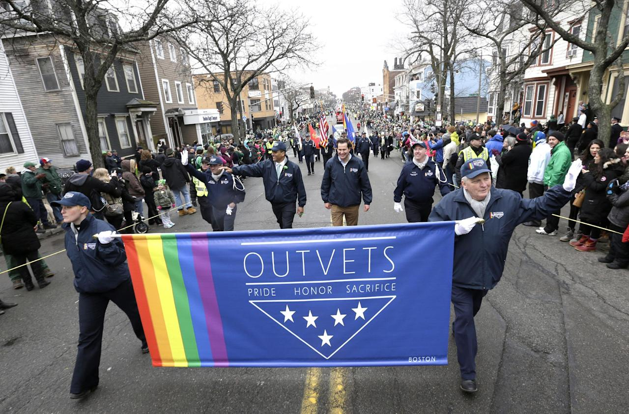 FILE - In this March 15, 2015 file photo, U.S. Rep. Seth Moulton, D-Mass., center without hat, marches with members of OutVets, a group of gay military veterans, during the St. Patrick's Day parade in Boston's South Boston neighborhood. An attorney representing parade organizers the parade said Wednesday, Aug. 3, 2016, that he filed an amended complaint to an earlier civil lawsuit accusing Boston Mayor Marty Walsh of strong-arming organizers in 2014 into inviting an LGBT veterans group to march in the parade. (AP Photo/Steven Senne, File)
