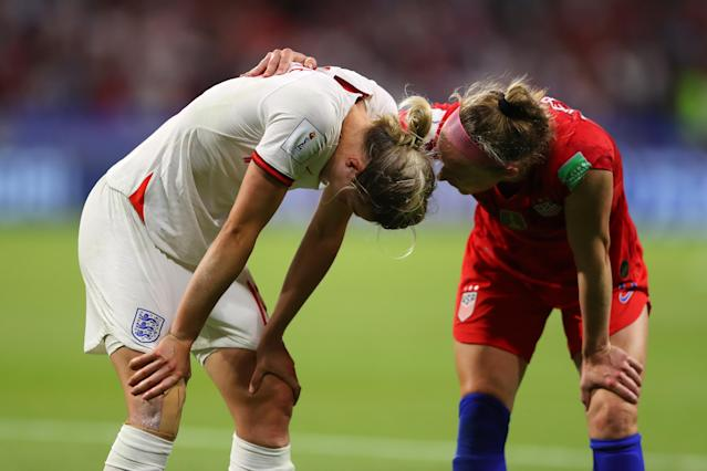 Ellen White of England is consoled by Becky Sauerbrunn of the USA following England's defeat in the 2019 FIFA Women's World Cup France Semi Final match between England and USA at Stade de Lyon on July 02, 2019 in Lyon, France. (Photo by Richard Heathcote/Getty Images)