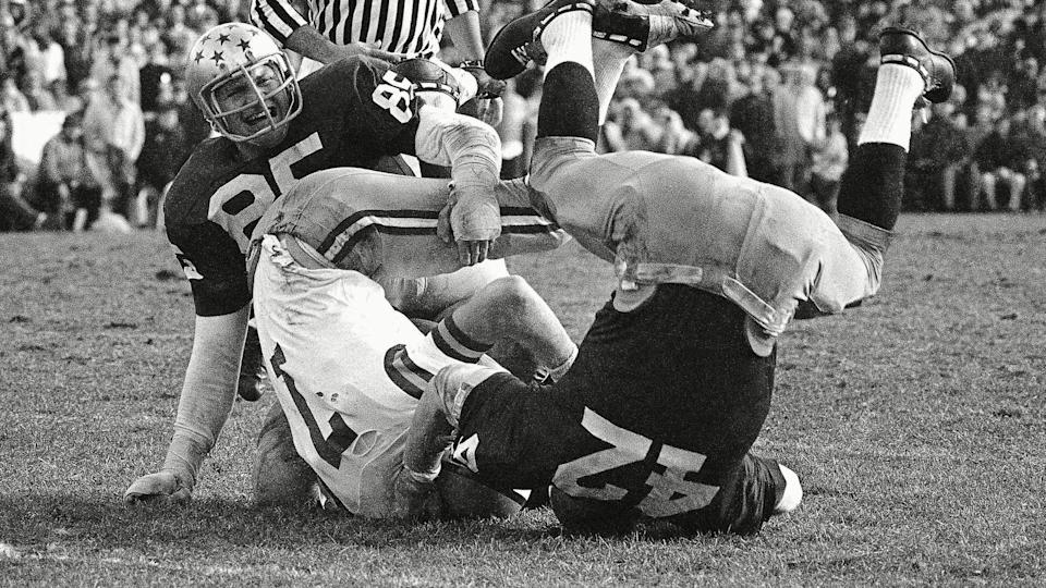 Mandatory Credit: Photo by Anonymous/AP/Shutterstock (6637112a)LSU quarterback Bert Jones (7) is upset and thrown for an eight yard loss in third quarter by Notre Dame's Tim Kelly (42) as Walt Patulski (85) also gets into the action in South Bend, Ind.