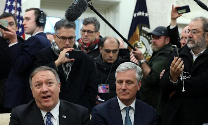 Mike Pompeo speaks to members of the media as National Security Adviser Robert O'Brien listens on Tuesday.