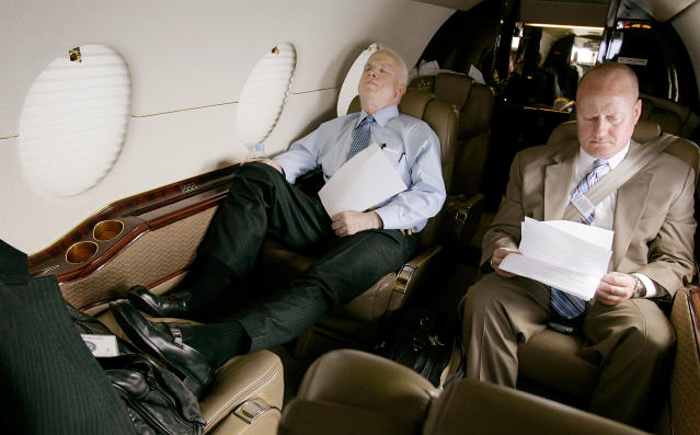 <p>Senator John McCain catches a nap on a private jet as he leaves Dulles International Airport in Virginia Monday afternoon, April 23, 2007, en route to a series of fund raisers in Connecticut, while his legislative assistant, Joe Donoghue, looks over some paperwork. (Photo: Stephan Savoia/AP) </p>