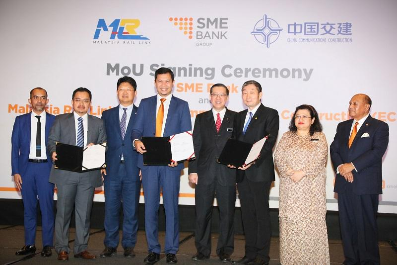 Finance Minister Lim Guan Eng (centre) during the MoU signing ceremony between SME bank, MRL and CCC-ECRL in Kuala Lumpur November 18, 2019.