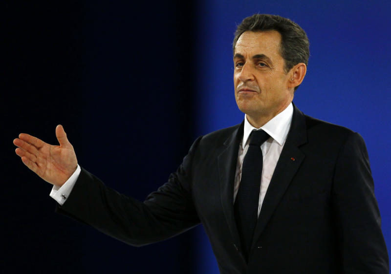 France's President and candidate for the upcoming election, Nicolas Sarkozy waves after his speech during a meeting in Villepinte, north of Paris, France, as part of his electoral campaign, Sunday March 11, 2012. (AP Photo/Francois Mori)