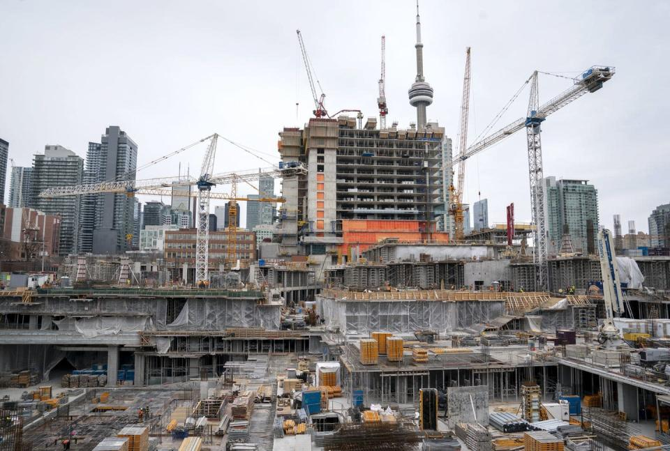 """<span class=""""caption"""">A construction site in Toronto in March 2020.</span> <span class=""""attribution""""><span class=""""source"""">THE CANADIAN PRESS/Frank Gunn </span></span>"""