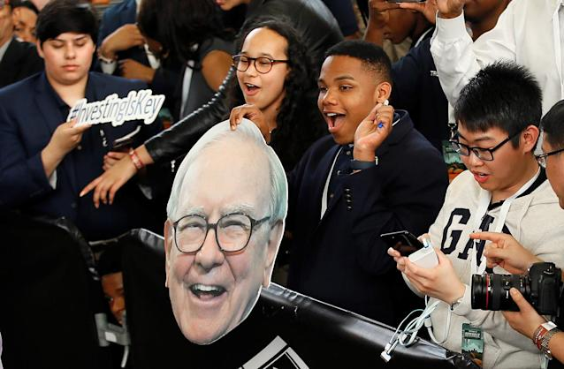 <p>Students cheer the arrival of Berkshire Hathaway CEO Warren Buffett during the annual Berkshire Hathaway shareholders' meeting in Omaha, Neb., May 7, 2017. (Rick Wilking/Reuters) </p>