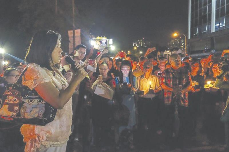 File picture of Pastor Raymond Koh's wife, Susanna Liew, addressing a crowd at a candlelight vigil outside the Selangor police headquarters in Shah Alam. — Picture by Yusof Mat Isa