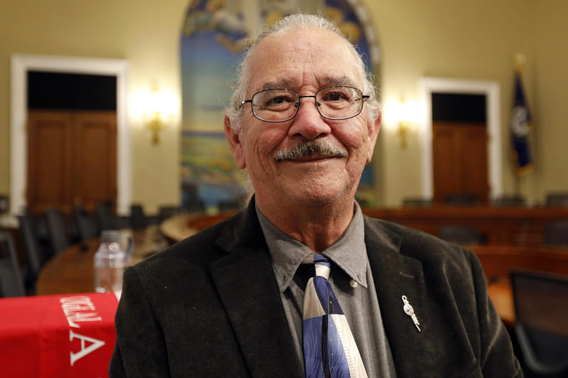 """In this June 25, 2019, photo, Oliver """"O.J."""" Semans, co-founder of Four Directions and a citizen of South Dakota's Rosebud Sioux Tribe, is photographed on Capitol Hill in Washington. Democratic presidential candidates will descend on Iowa next week to do something that Native Americans say doesn't happen enough: Court their vote.  At least seven White House hopefuls have said they'll attend a forum in Sioux City on Monday and Tuesday named for longtime Native American activist Frank LaMere, who died in June. Indigenous people hold profound respect for their tribal elders and leaders, who can sway the vote of whole reservations, Semans said. (AP Photo/Kali Robinson)"""