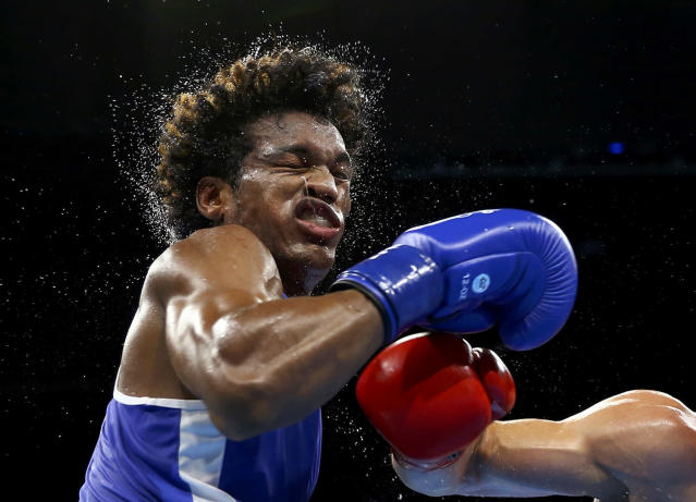 <p>Carlos Andres Mina of Ecuador competes in the men's light heavy (81kg) quarterfinals at the Rio Olympics on August 14, 2016. (REUTERS/Peter Cziborra) </p>