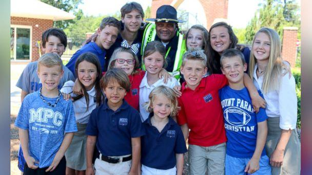 PHOTO: Jonathan Broadnax, the security guard at Mount Paran Christian School, was bombarded with hugs from students on the last day of school. (Courtesy Mount Paran Christian School )