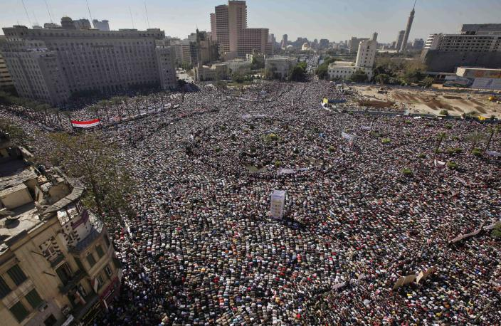 Tens of thousands of Egyptians pray and celebrate the fall of the regime of former President Hosni Mubarak, and to maintain pressure on the current military rulers, in Tahrir Square in downtown Cairo, Egypt Friday, Feb. 18, 2011.