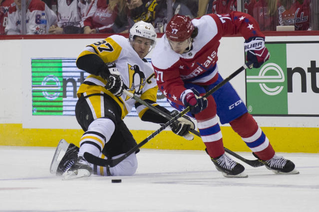 Pittsburgh Penguins center Sidney Crosby (87) defends against Washington Capitals right wing T.J. Oshie (77) in the first period of an NHL hockey game, Wednesday, Dec. 19, 2018, in Washington. (AP Photo/Alex Brandon)