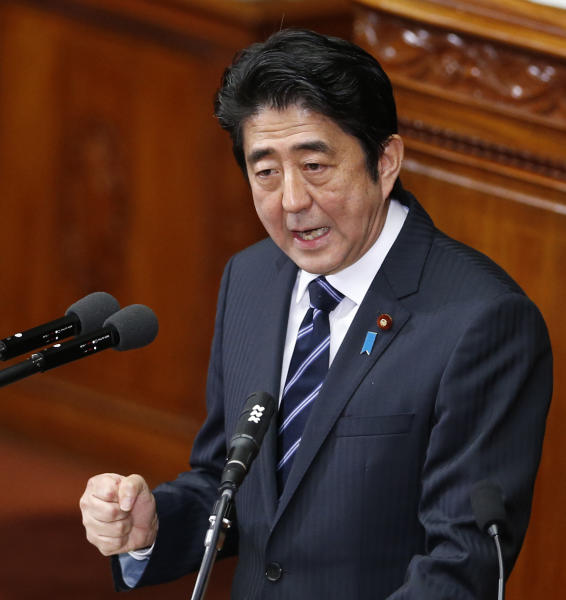"Japanese Prime Minister Shinzo Abe delivers his policy speech during an opening session at the lower house of parliament in Tokyo, Monday, Jan. 28, 2013. Abe whose government faces stiff challenges in reviving the economy and managing an escalating dispute with China over an island chain in the East China Sea said ""Let us have strong determination to regain a powerful economy."" Abe also said, ""We will take every measure to promote and manage and we will give our best efforts to guard the remote islands at the borders."" (AP Photo/Koji Sasahara)"