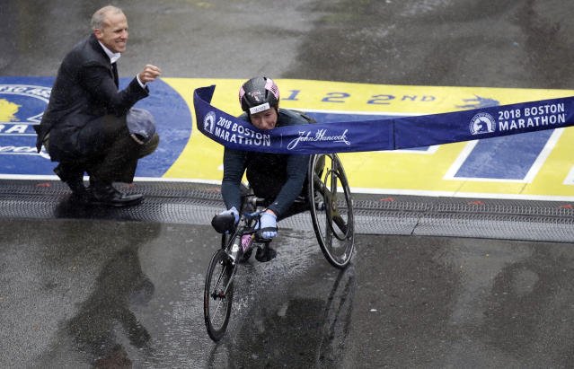 Tatyana McFadden, of the United States, crosses the finish line to win the women's wheelchair division of the 122nd Boston Marathon on Monday, April 16, 2018, in Boston. (AP Photo/Charles Krupa)