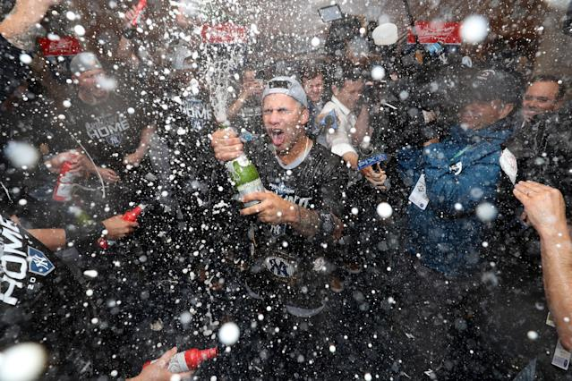 """Oct 7, 2019; Minneapolis, MN, USA; The <a class=""""link rapid-noclick-resp"""" href=""""/mlb/teams/ny-yankees/"""" data-ylk=""""slk:New York Yankees"""">New York Yankees</a> celebrate their victory in the locker room after defeating the <a class=""""link rapid-noclick-resp"""" href=""""/mlb/teams/minnesota/"""" data-ylk=""""slk:Minnesota Twins"""">Minnesota Twins</a> in game three of the 2019 ALDS playoff baseball series at Target Field. Mandatory Credit: Jesse Johnson-USA TODAY Sports"""