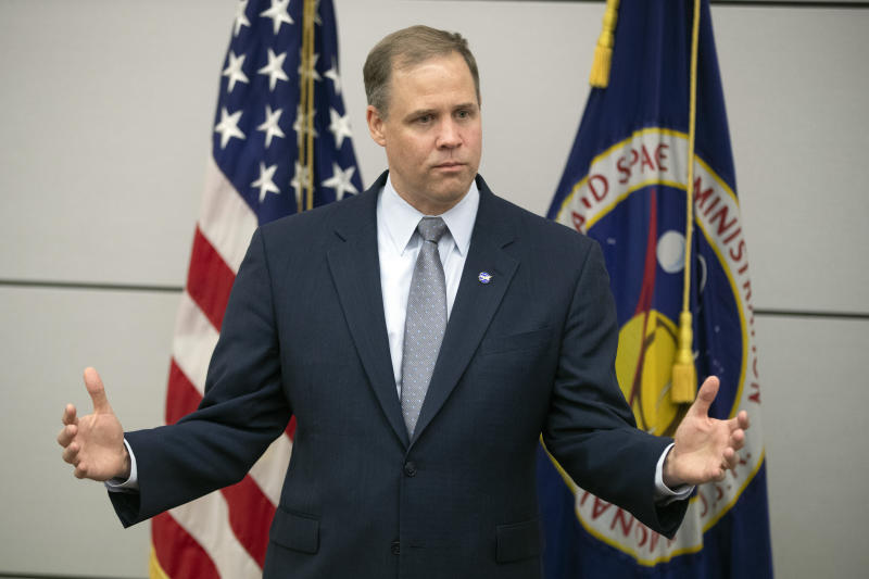 Administrator of the National Aeronautics and Space Administration (NASA) Jim Bridenstine speaks during a news conference at the U.S. embassy in Moscow, Russia, Friday, Oct. 12, 2018. (AP Photo/Pavel Golovkin)