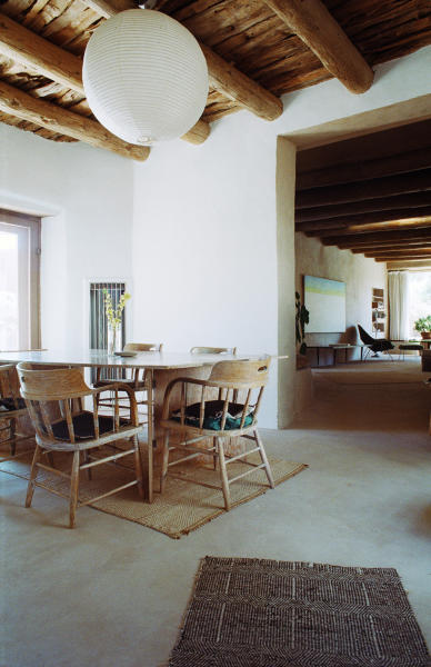 In this 2007 photo provided by the Georgia O'Keeffe Museum, a light designed by sculptor Isamu Noguchi hangs in the dining room of the home and studio where artist Georgia O'Keeffe lived and worked in Abiquiu, N.M. Noguchi's lighting sculptures were inspired by Japanese lanterns used for ancestor worship and they became widely imitated classics of mid-20th century home design. This lamp was a gift from Noguchi to O'Keeffe, who shared an affinity for the spare, bold, clean shapes and aesthetics that define modernism in both art and in home design. (AP Photo/Copyright Georgia O'Keeffe Museum, Herb Lotz)