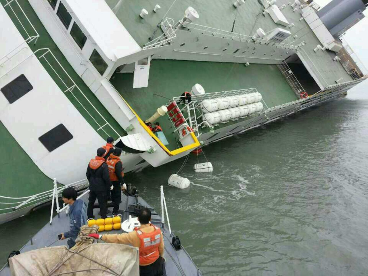 JINDO-GUN, SOUTH KOREA - APRIL 16: In this handout image provided by the Republic of Korea Coast Guard, passengers are rescued by the Republic of Korea Coast Guard from a ferry sinking off the coast of Jindo Island on April 16, 2014 in Jindo-gun, South Korea. The ferry identified as the Sewol was carrying about 470 passengers, including students and teachers, traveling to Jeju island. (Photo by The Republic of Korea Coast Guard via Getty Images)