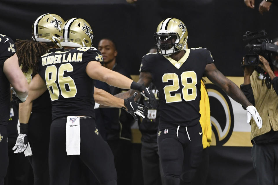 New Orleans Saints running back Latavius Murray (28) is congratulated after scoring a touchdown, during the first half at an NFL football game against the Carolina Panthers, Sunday, Nov. 24, 2019, in New Orleans. (AP Photo/Bill Feig)