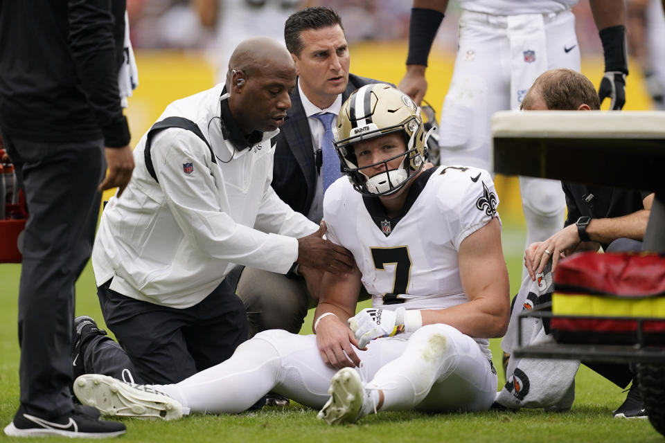 New Orleans Saints wide receiver Taysom Hill is tended to after being injured in the first half of an NFL football game against the Washington Football Team, Sunday, Oct. 10, 2021, in Landover, Md. (AP Photo/Alex Brandon)