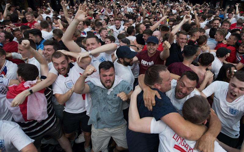 England football fans celebrate after England scored the first goal in the England v Sweden quarter final match in the FIFA 2018 World Cup Finals at Croydon Boxpark - Getty Images